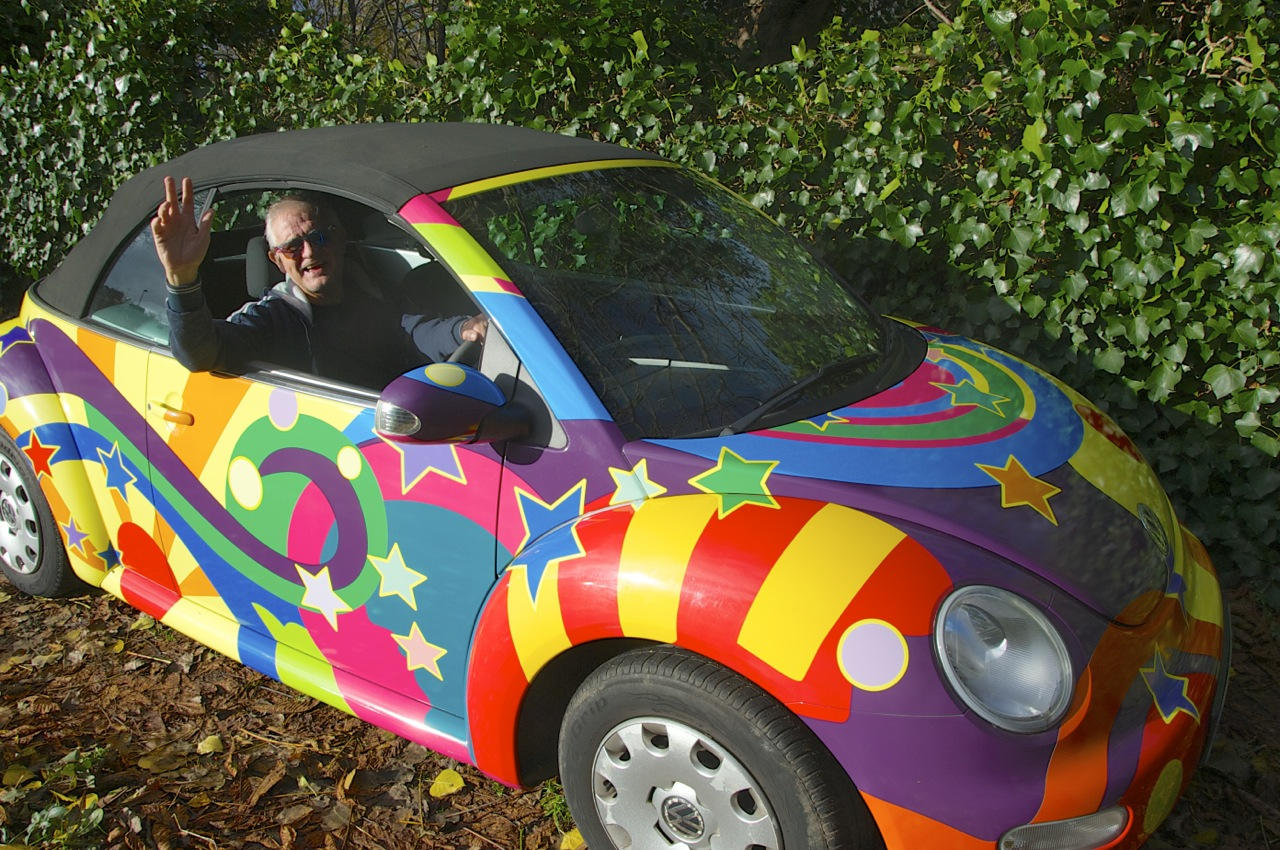 Tony Messenger in his psychadelic-wrapped car photographed by Beowulf Mayfield